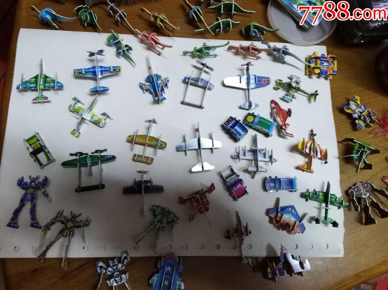 小灵龙积木卡叠成的小车玩具,玩具,飞机,变形金刚等一拼装恐龙作文500字图片