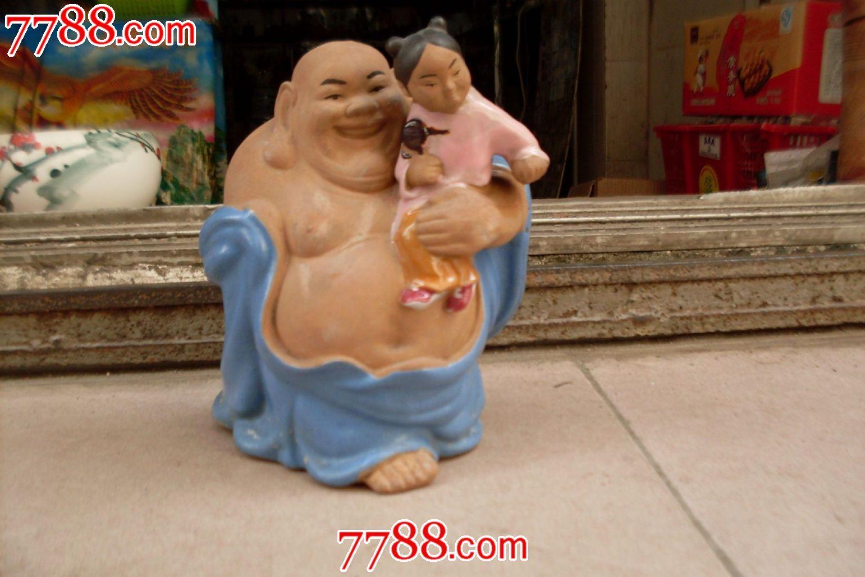 石湾陶瓷佛与小孩