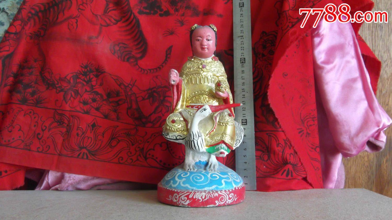 木雕神仙童子骑在仙鹤上,手里拿着天女散花的花篮,包实木雕