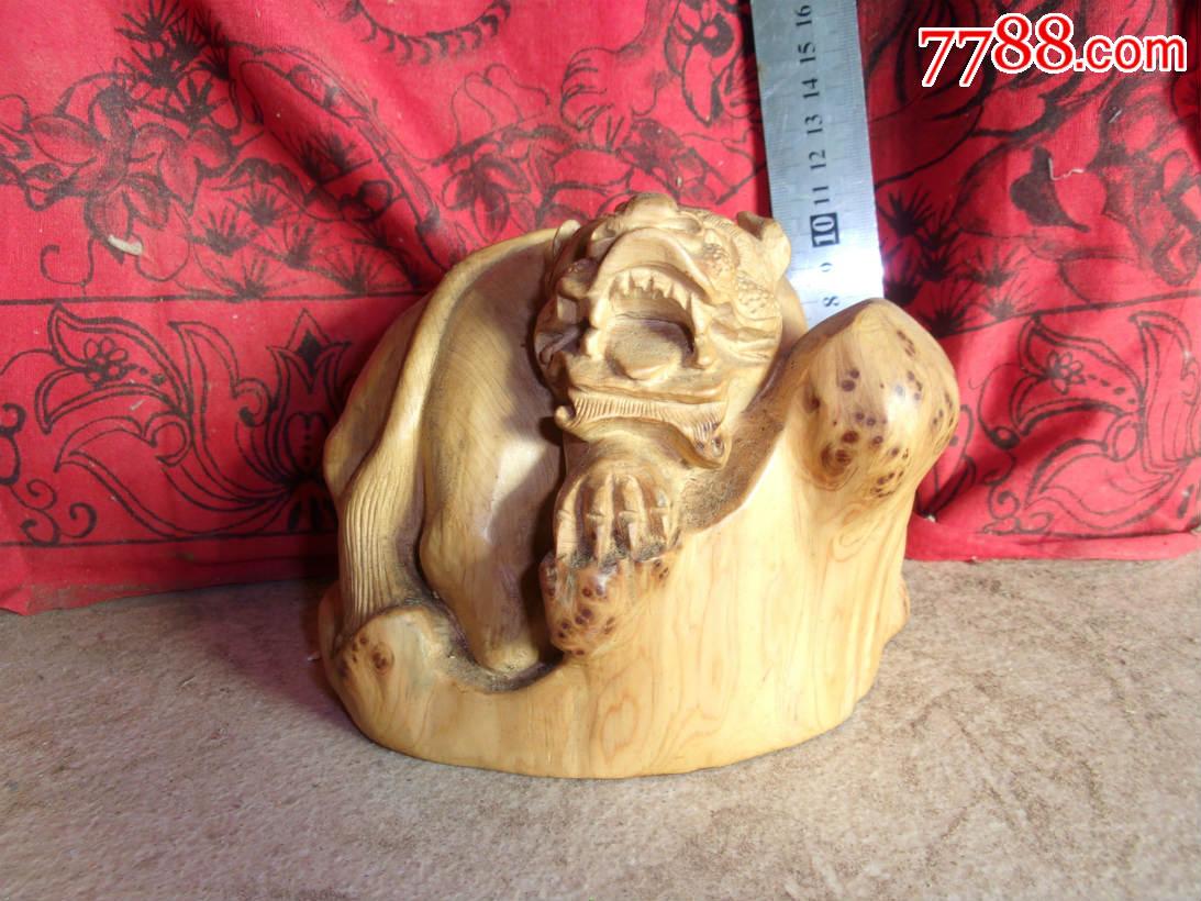 纯手工雕刻崖柏木木雕动物瑞兽雕件一只,这个动态挺矫健威猛的